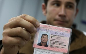 Jan. 15, 2015 - Russian Federation - MOSCOW REGION, RUSSIA. JANUARY 15, 2015. Migrant worker from Tajikistan displays a labour licence issued for him at the Moscow Region's United Migration Centre. Artyom Korotayev/TASS (Credit Image: © Artyom Korotayev/TASS/ZUMA Wire)